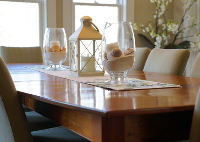 picture of dining room table and chairs- cape seashore home